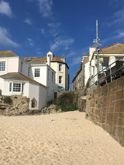 View of Pier House from the lovely south facing and sheltered harbour beach.  A real safe little haven for the little ones or grown ups alike