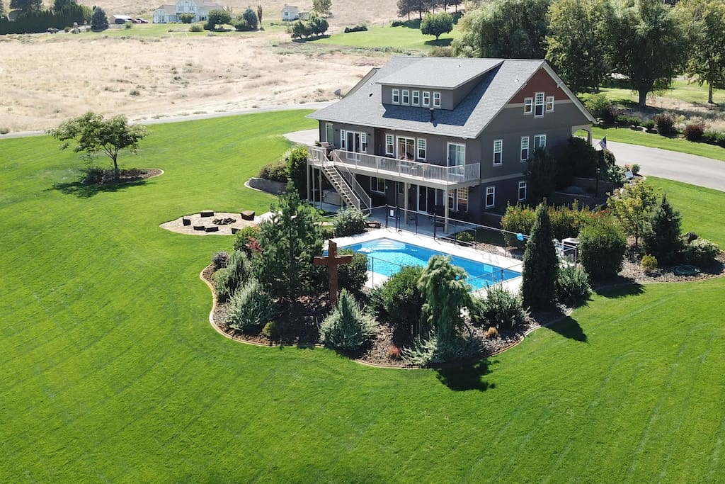 2.5 acres of manicured landscaping, with a pool, hot tub and fire pit for your personal use!