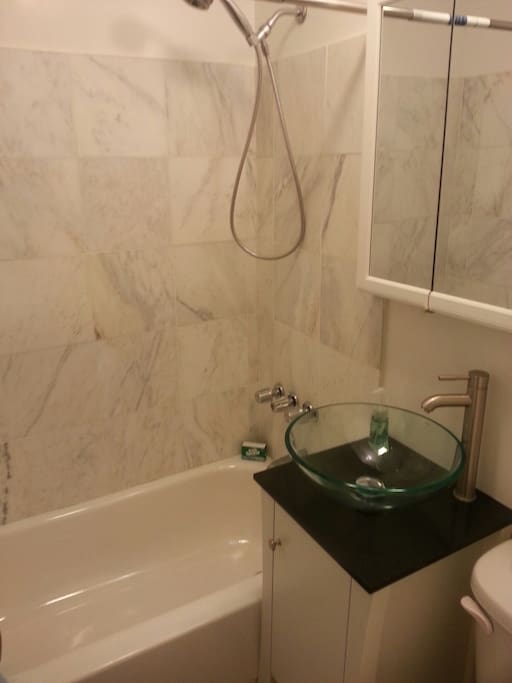 Garden Apartment has renovated Marble Bathroom