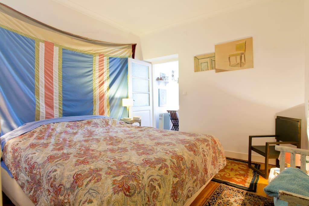 Bedroom with queen-size bed.