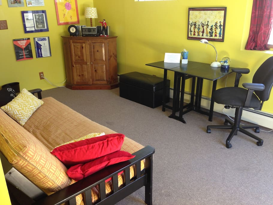 The Music Room has a double futon bed, a TV, and a nice desk/work space.