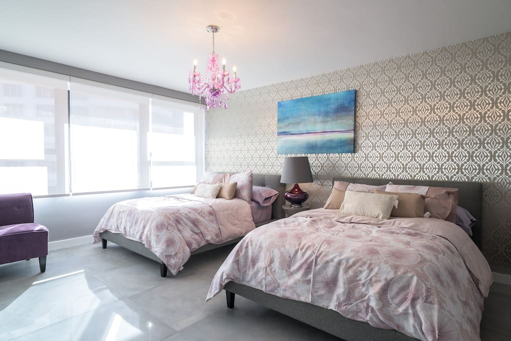 Master bedroom with two full beds