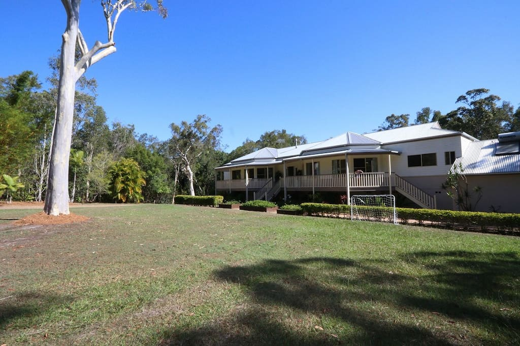 Noosa Gums overlooks an expansive front grassed area and towering eucalypts