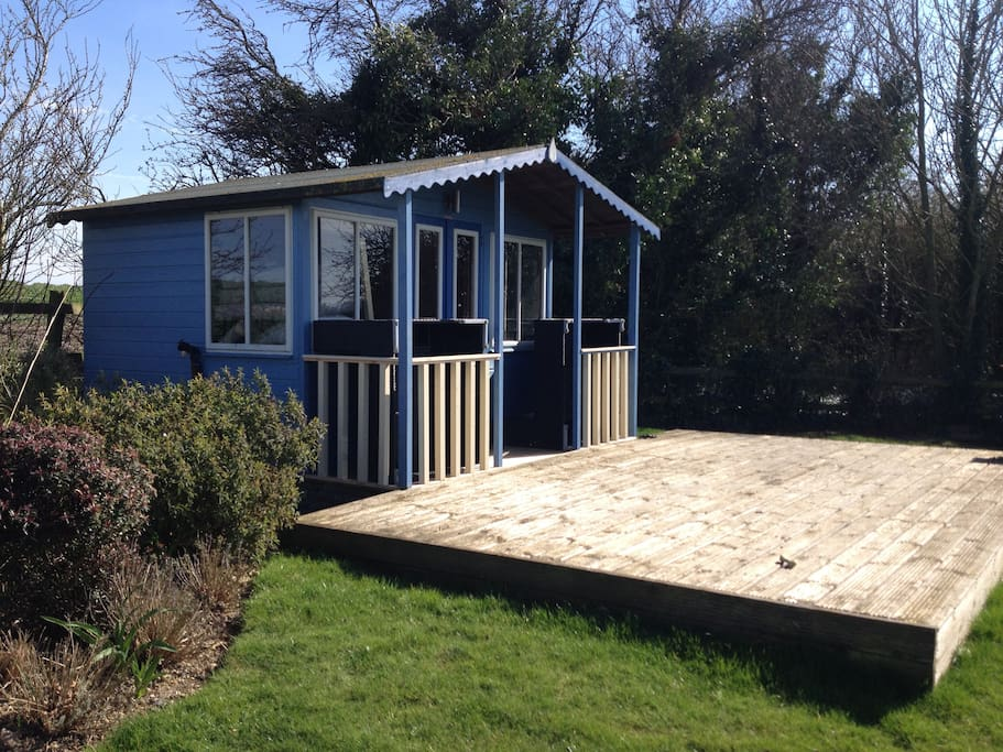 Garden summerhouse has drinks fridge & deck