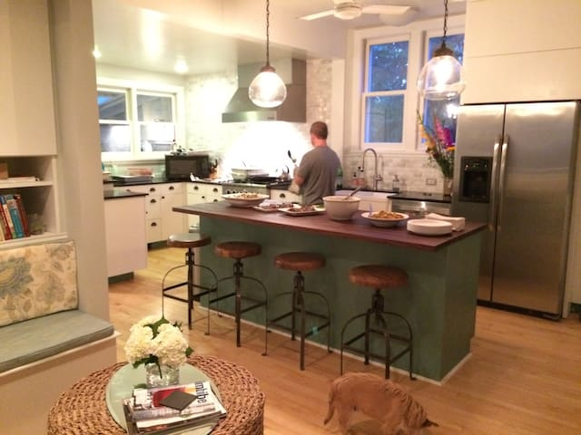 Kitchen opens to dining room that seats 10. Island seats 4 & banquette seating for 5.