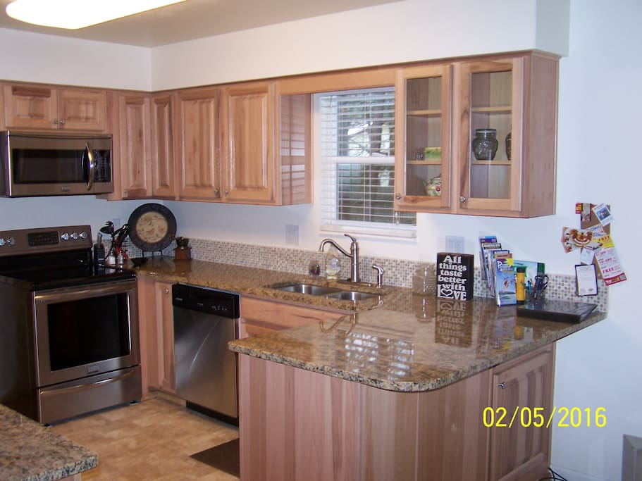 Kitchen with granite and stainless steel applicances