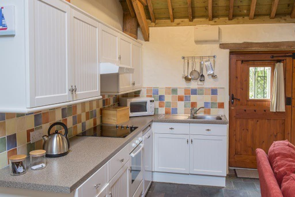 The kitchen is fully equipped including dishwasher