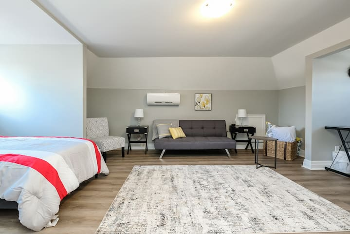 Loft space, including one twin XL bed and one pull-out sofa bed.