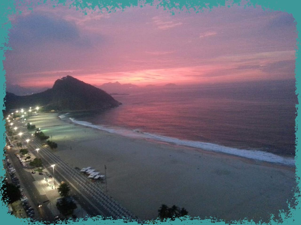 The picture shows the Leme beach from above, right before sunrise. And the flat stays just near the agglomeration of selling cabins we see on the sand.  The Anchieta street, where it is located, is the Leme Palace Hotel street - therefore the cabins.