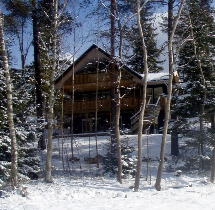 Back of House in March 2018. Three minutes walk through trees to secluded lake surrounded by cliffs.