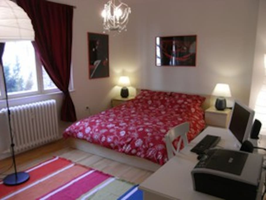 The large bedroom with computer and internet.