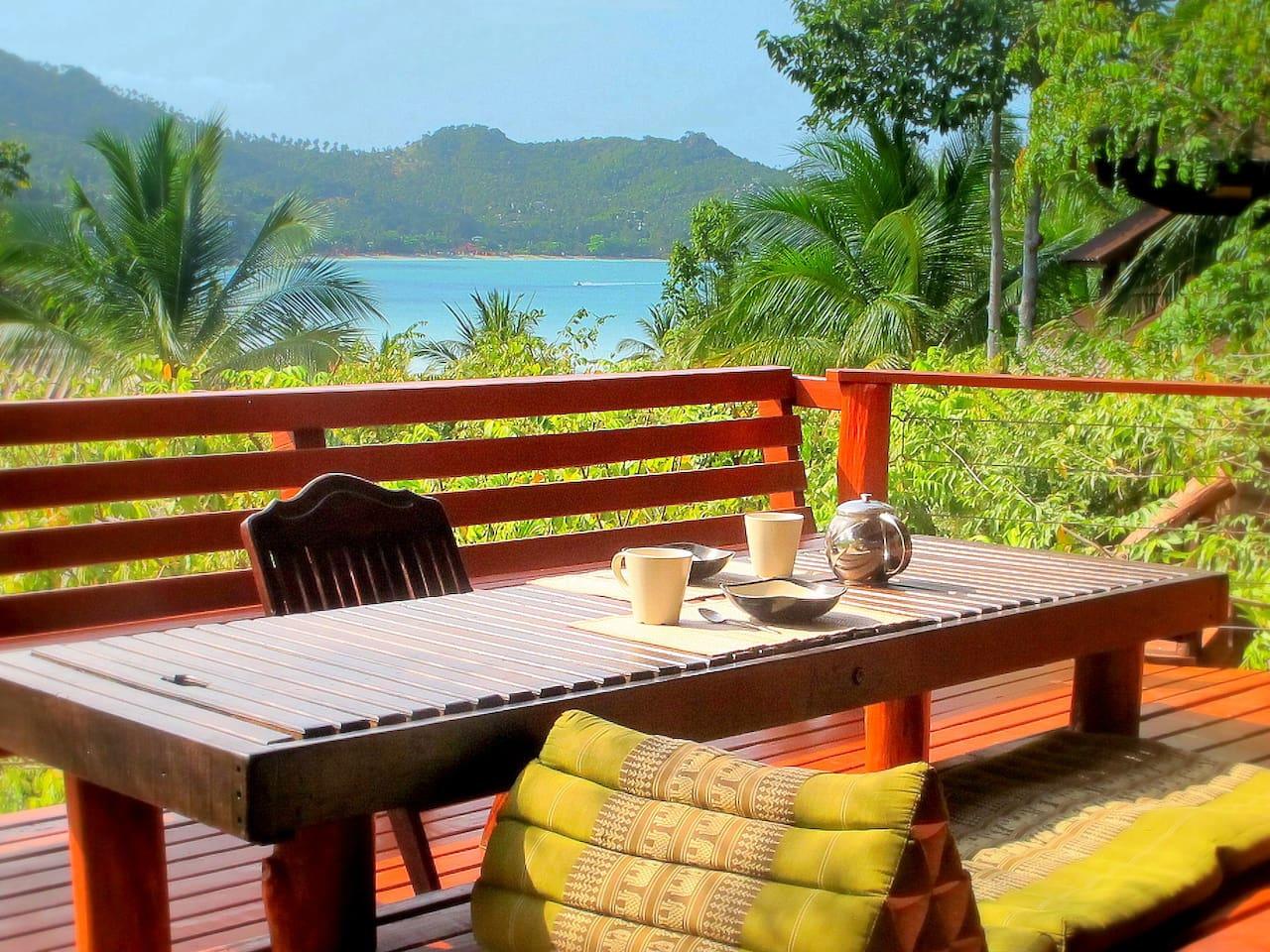 Enjoy breakfast on the verandah with mountain and sea views.