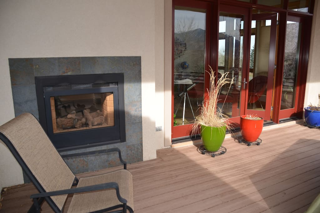 Deck with indoor/outdoor fireplace. Overlooking Mt Sanitas & Boulder Flatirons.
