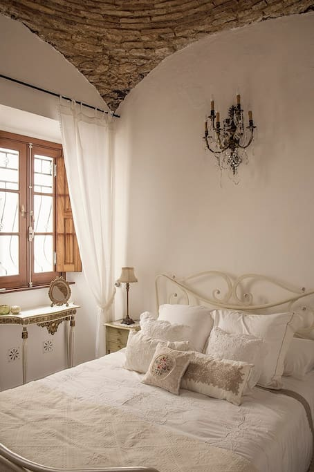 """The downstairs bedroom is just as it looks in the photos: romantic and elegant."""