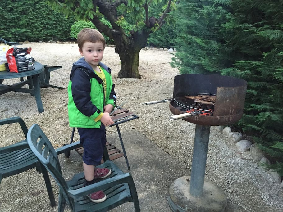 Our little boy supervising the grill