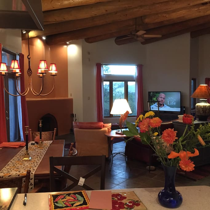 LR with shepherd's fireplace, large screen TV, southwestern furnishing, antique hickory dining table for 6-8