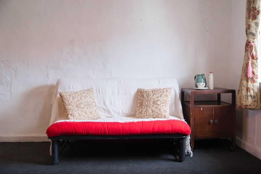 The futon sofa bed in room two.