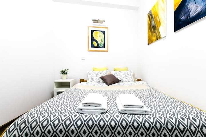 Second bedroom with queen size bed, wardrobe and chest of drawers
