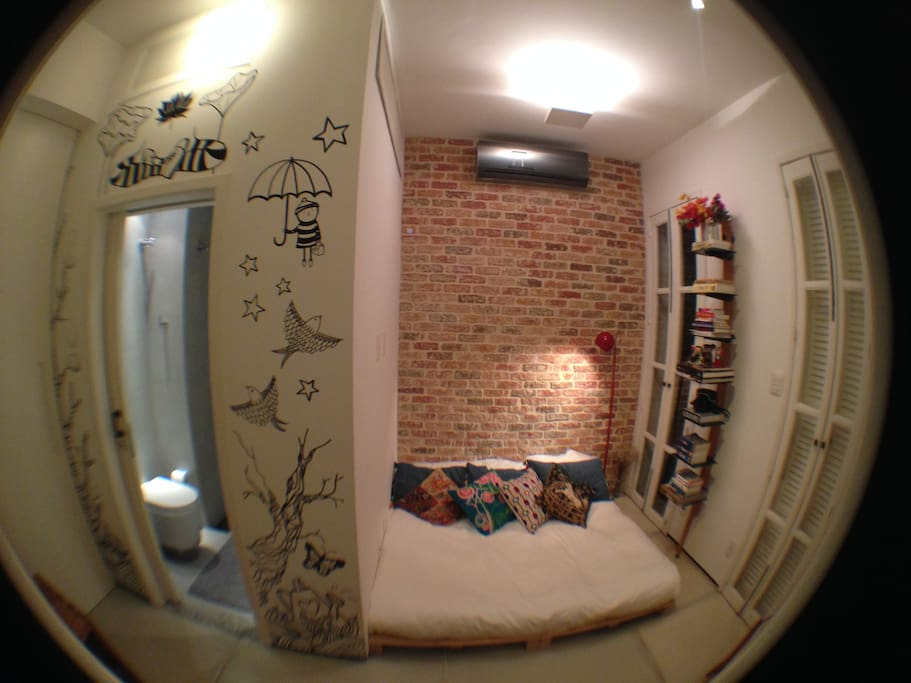 Fisheye view showing  the bed and the bathroom