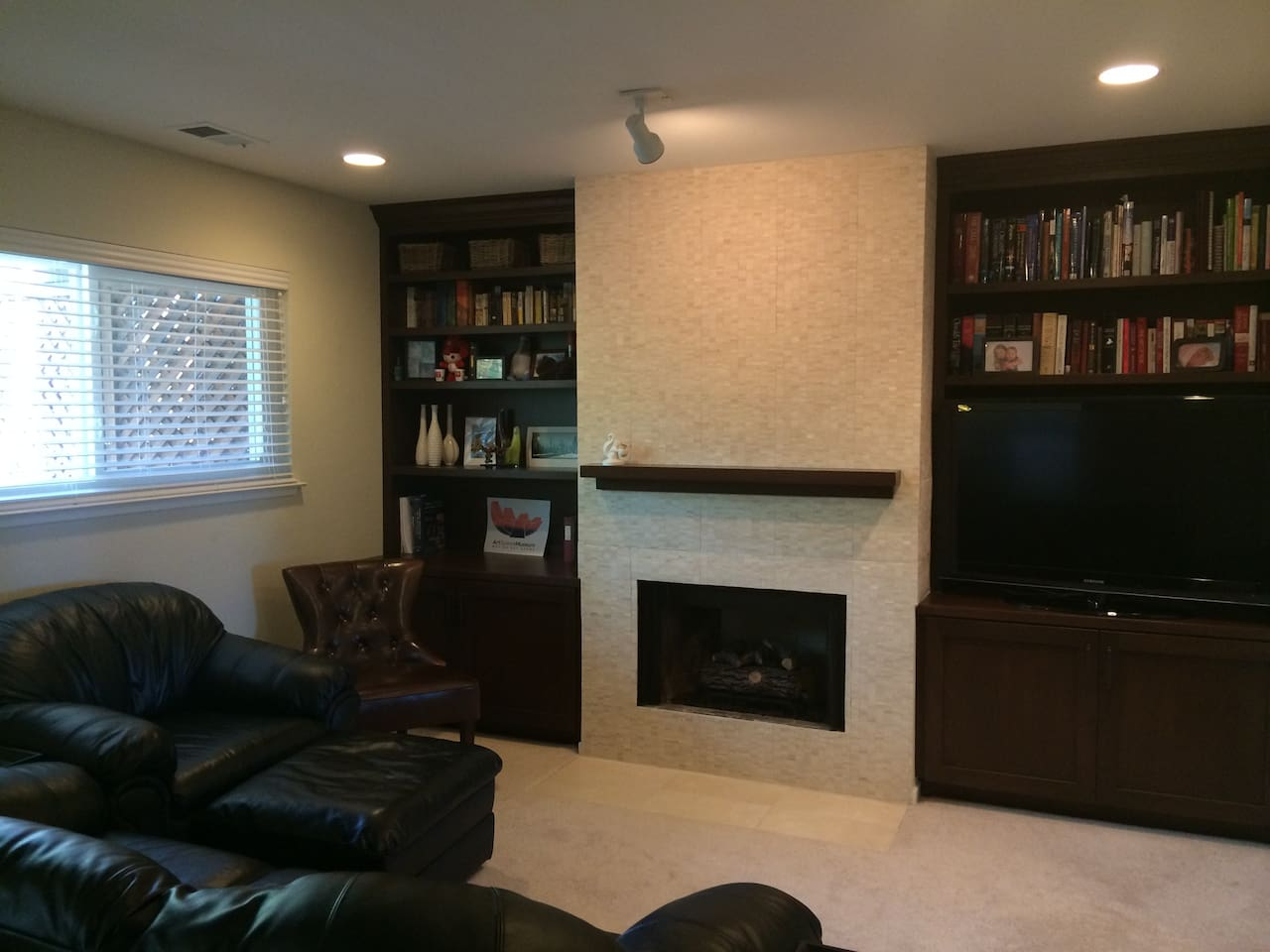 Living Room - Large TV, comfy seating.