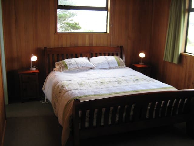 Enjoy views of the estuary and the mountains from the bedroom.