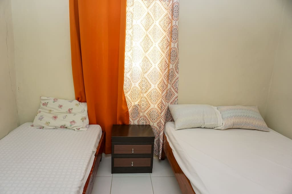 The triple room with one double bed and one single bed.