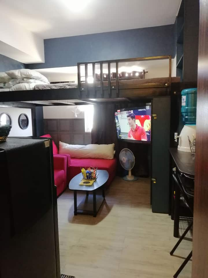 A homely studio condo unit w/ A/C & smart TV