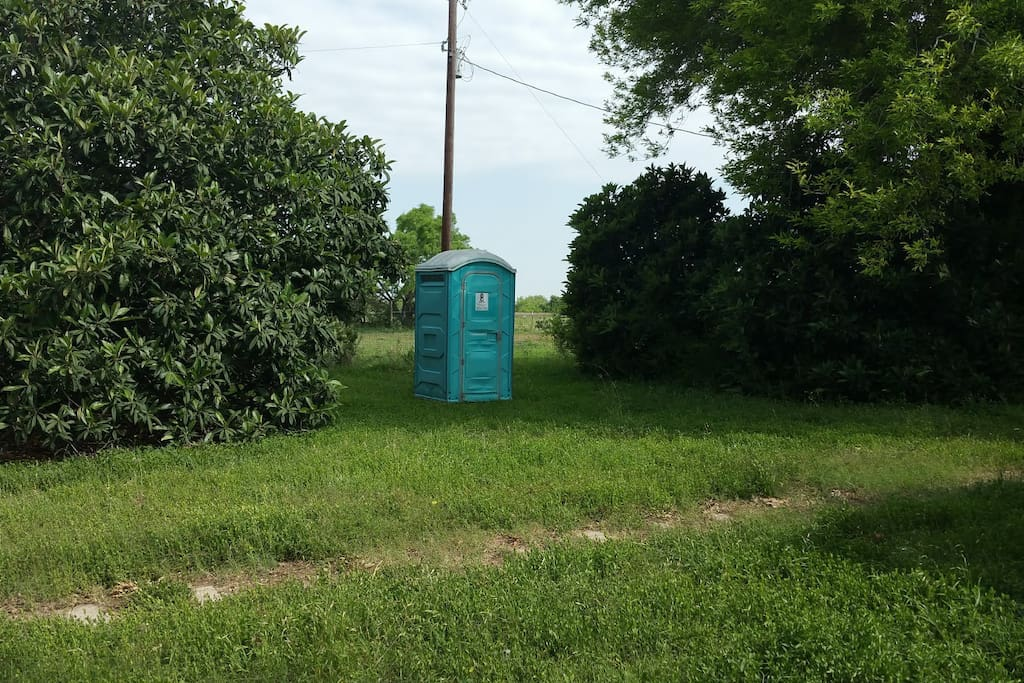 There is a port-o-potty on the adjacent lot near the walkway.
