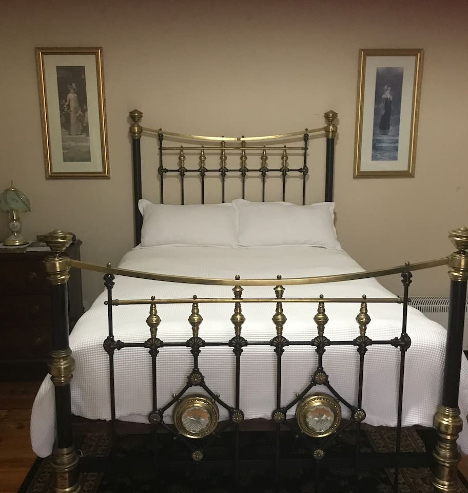 Authentic 19th. Century brass bed, which belonged to Lydia' parents.