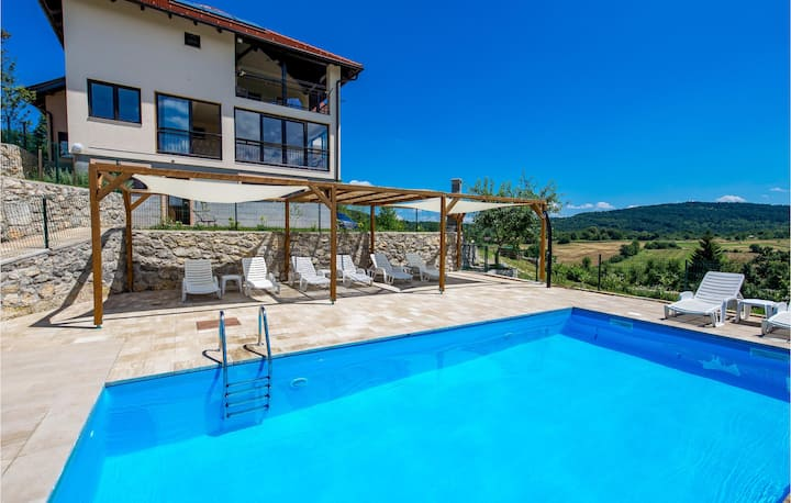 Beautiful apartment in Rakovica with Outdoor swimming pool, WiFi and 1 Bedrooms