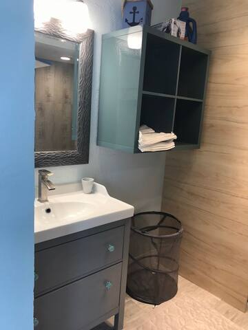 great full bathroom off bedrooms downstairs and living space