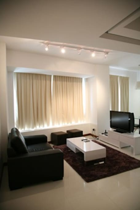 Living room with TV.  Also includes desk and office chair for working.