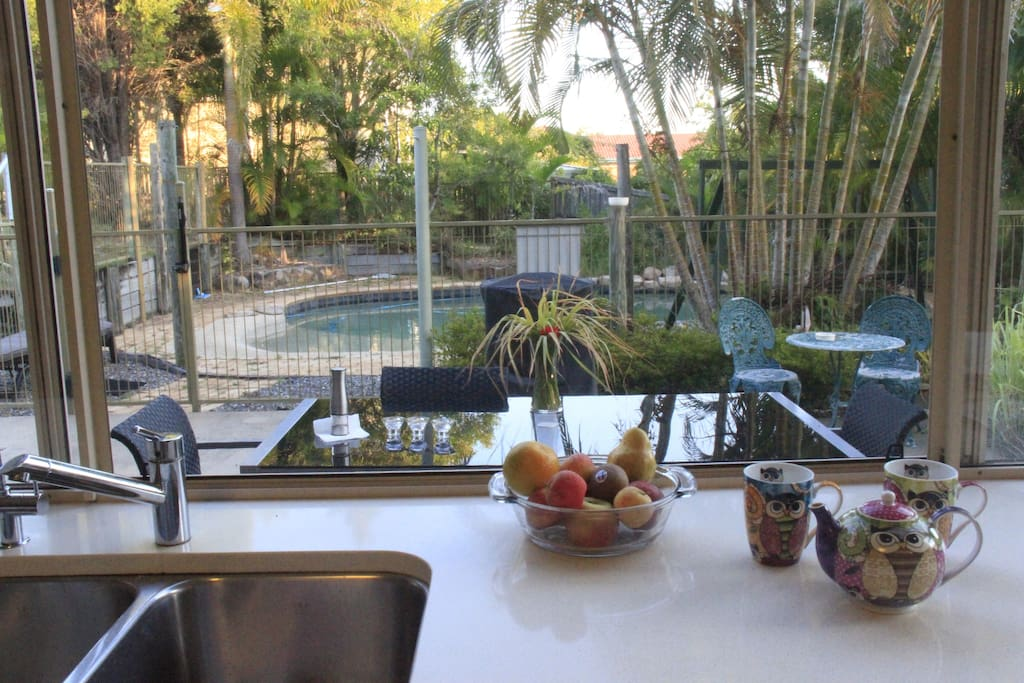 Wonderful view from the kitchen on the pool and outdoor dinning area.