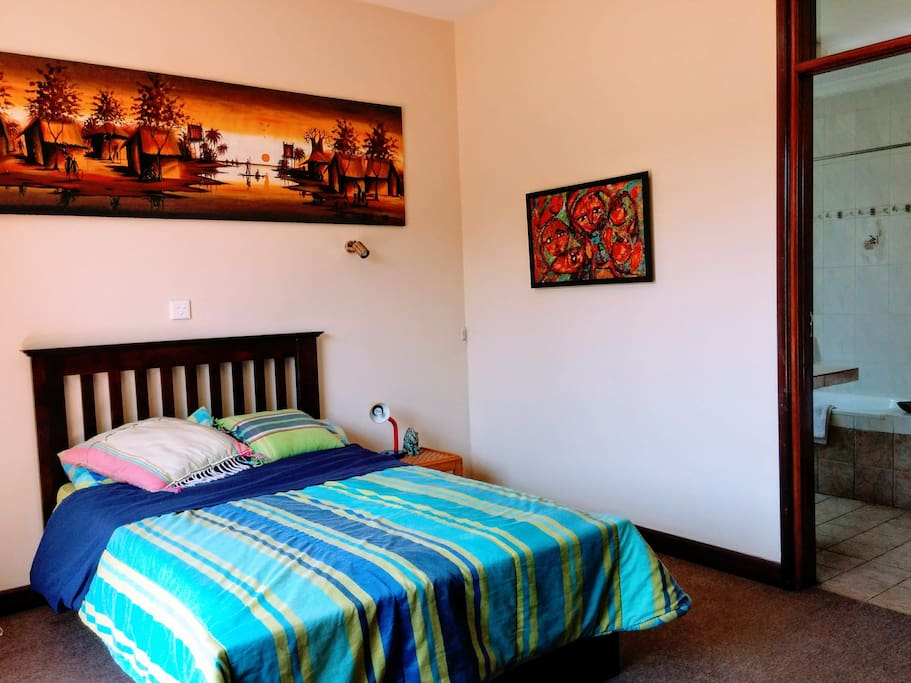 The first bedroom has a full mattress bed.