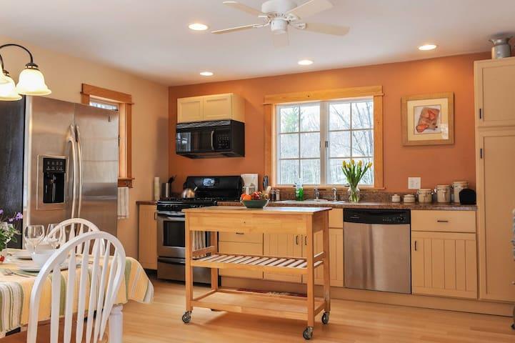 Bright, full kitchen.