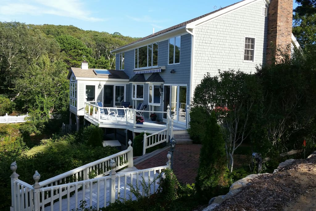 Expansive decks and patio overlooking lake and ocean