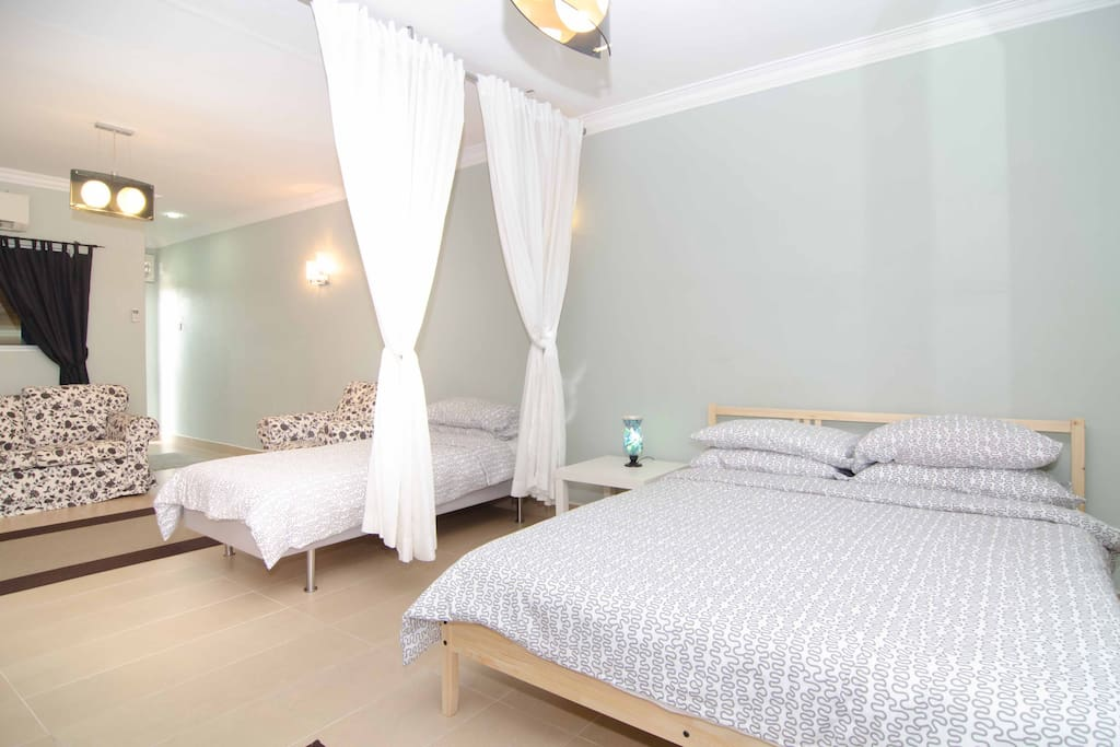 Cozy and spacious penthouse furnished with one queen size bed and one single bed. Additional mattresses available.