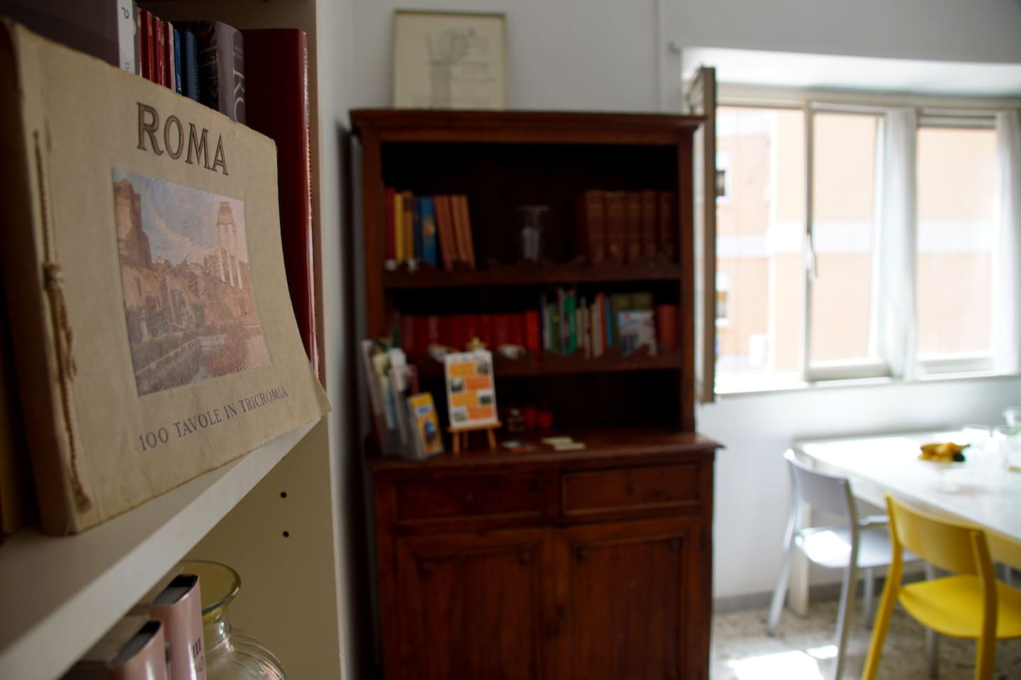 Living room, with a whole bookcase full of books on Rome to help orient your trip and learn about this city's amazing history