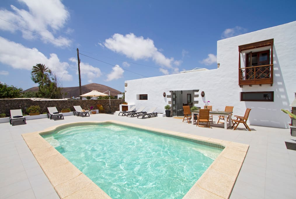 Shared solar heated pool and outside dining area at Tiagua81.