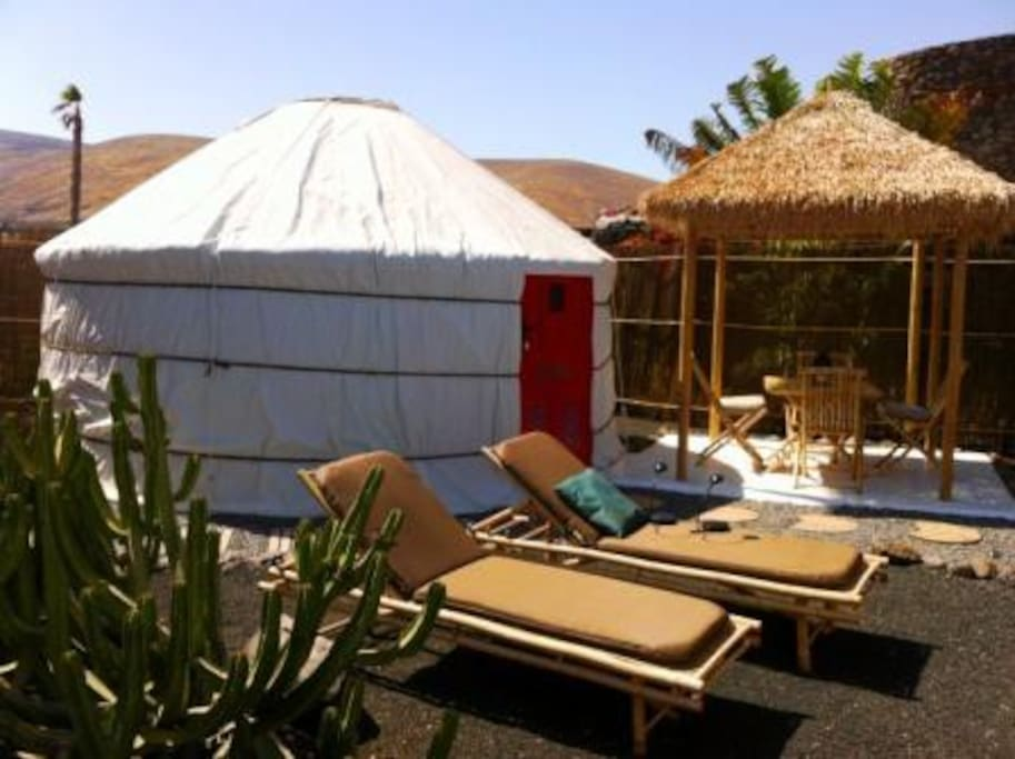 The Eco Palm Yurt with outdoor Bamboo Dining Hut and Sunbathing Area.