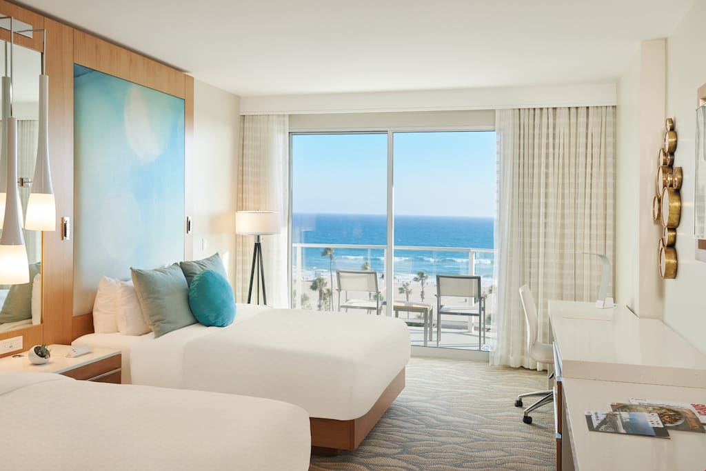 Relax in the 2 queen beds at the Oceanfront Guestroom after a day at the beach