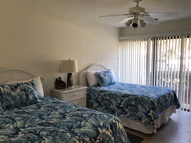 GUEST BEDROOM WITH TWO DOUBLE BEDS, HD TV, BLUE RAY PLAYER, AND LARGE CLOSET