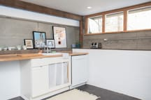 Full size dishwasher, collections of artwork and plenty of counter space.