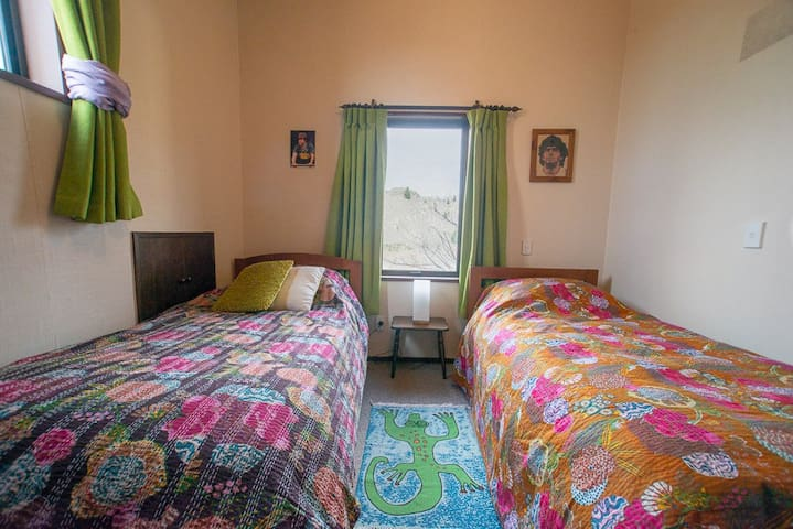 """The """"Diego Maradona Room"""" with 2 single slat beds, small but cosy for the travelers on a budged."""