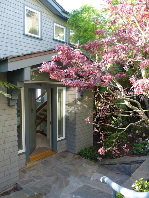 Front entrance, down 2 flights of stairs below quiet residential street