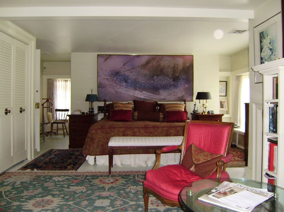 King Suite with Oriental  rugs and cozy chairs.