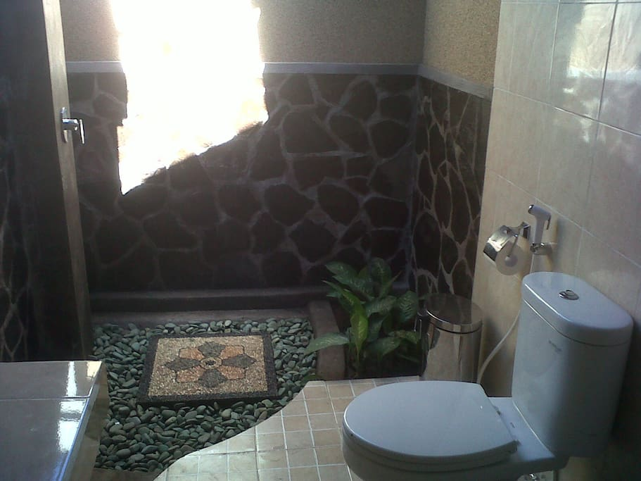 Bathroom where you can take a shower under the Balinese sky