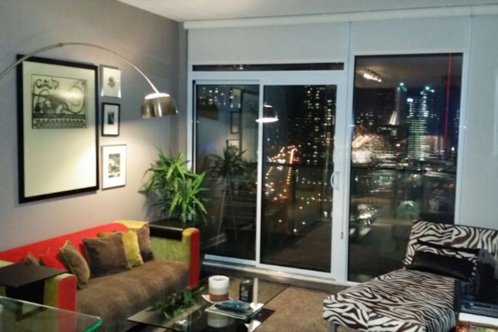 Elegant living space for you to relax as you watch the CN  Tower light up the night