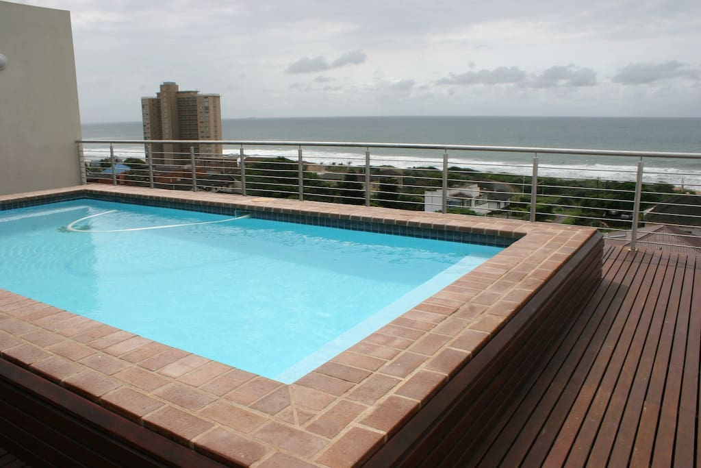 Pool with ocean view and brai area