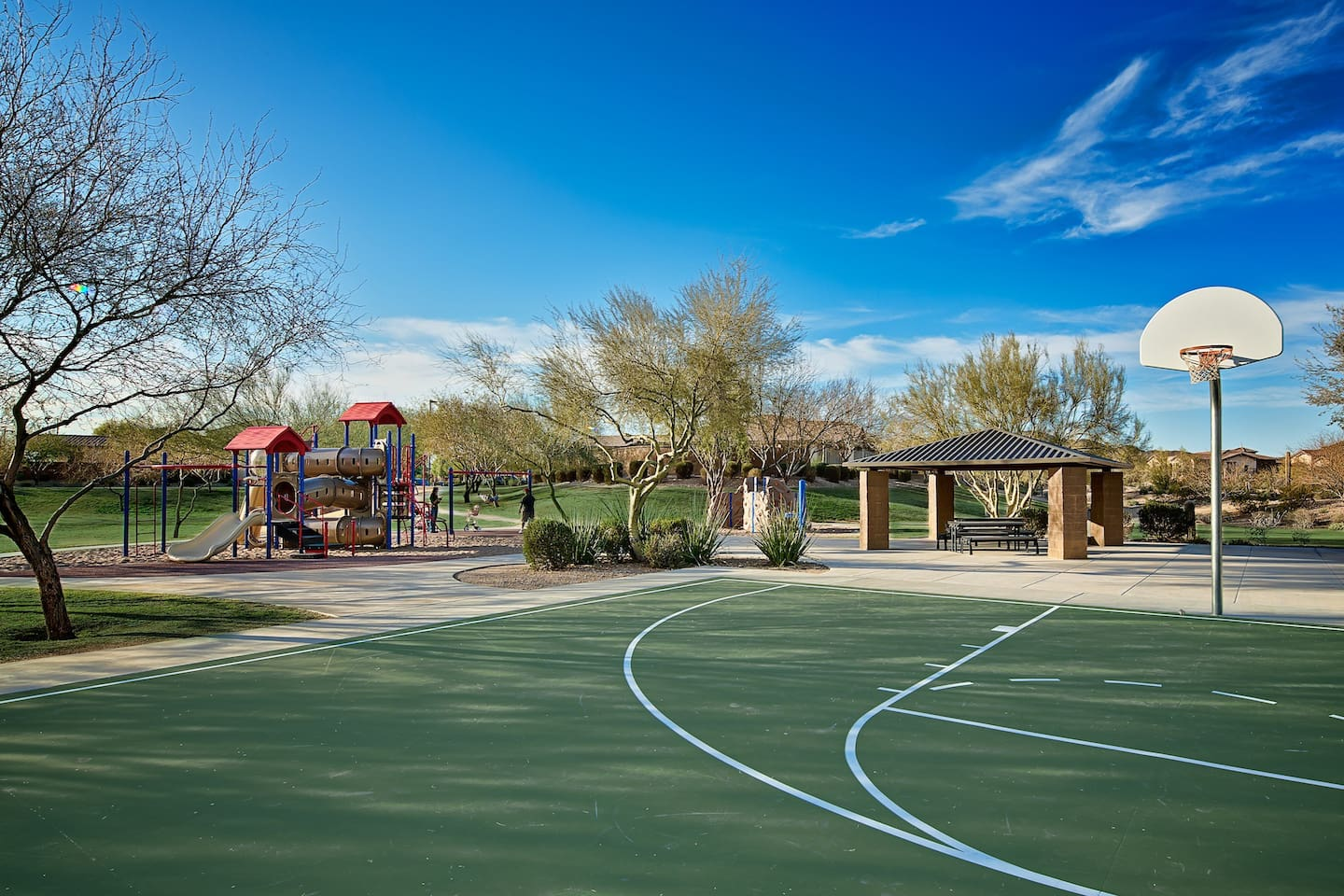 Nearby park with basketball court and playground.